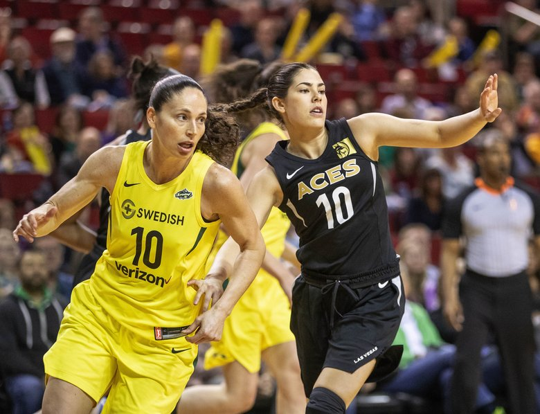 Las Vegas guard Kelsey Plum is assigned to defend Seattle's Sue Bird in the first quarter.  (Dean Rutz/The Seattle Times)