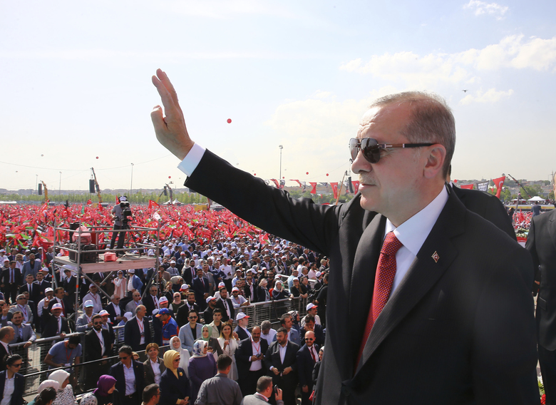 Turkish President Recep Tayyip Erdogan salutes a rally in solidarity with Palestinians before an extraordinary summit of the Organization of Islamic Cooperation (OIC), in Istanbul, Turkey, Friday, May 18, 2018. Turkey has called on Muslim nations to stand with Palestinians and to work to stop countries joining the United States in relocating their Israeli embassy from Tel Aviv to Jerusalem.(Presidential Press Service/Pool via AP)