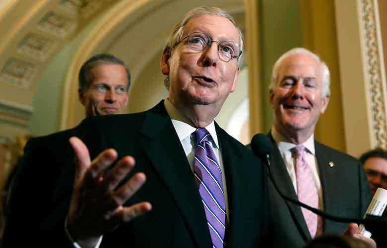Senate Majority Leader Mitch McConnell (center) speaks after a policy luncheon on May 8, 2018, in Washington. McConnell is accompanied by two senators named John: Sen. John Thune, R-South Dakota (left) and Sen. John Cornyn, R-Texas. (AP Photo / Alex Brandon)