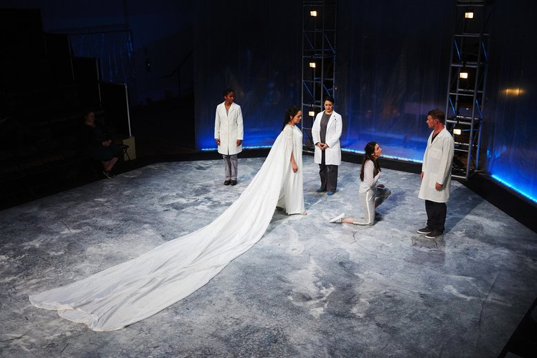 "Tess Altiveros (center left) and Magda Gartner in Seattle Opera's ""O+E.""  (Philip Newton)"