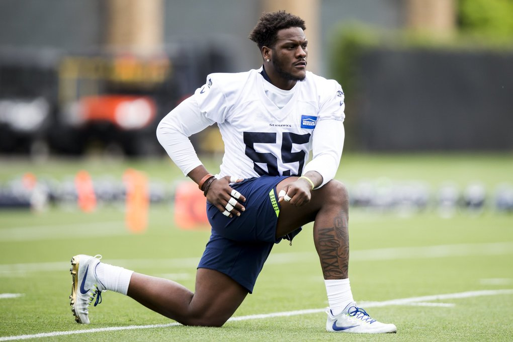 Seahawks defensive end Frank Clark stretches for warmups as the Seattle Seahawks hold minicamp at the Virginia Mason Athletic Center in Renton Tuesday June 13, 2018. (Bettina Hansen / The Seattle Times)