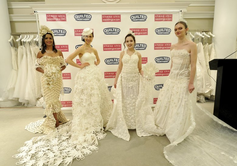 The top three winning wedding-dress designs and the fan favorite, left, are modeled at the 2018 Toilet Paper Wedding Dress Contest presented by Cheap Chic Weddings and Quilted Northern at Kleinfeld Bridal in New York. The fashion show finale event highlighted the top 10 designs from more than 1,500 entries submitted to the competition. (Diane Bondareff / The Associated Press)