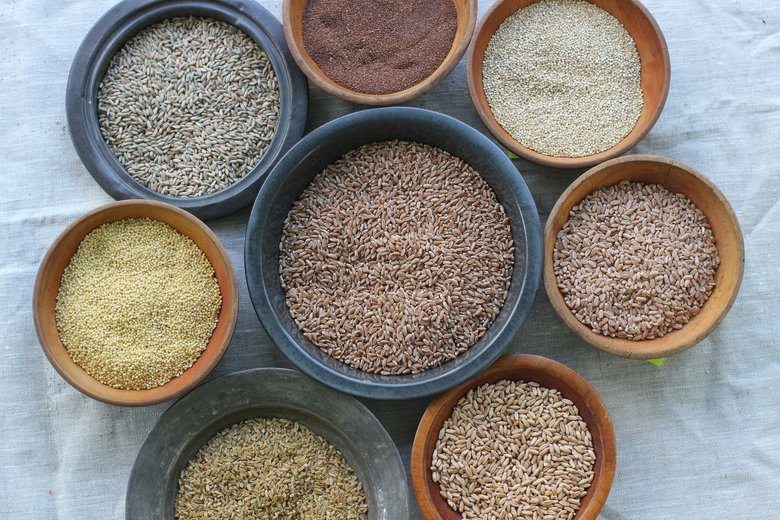 Whole grains, clockwise from top: teff, quinoa, farro triticale, freekeh, millet, rye berries and wheat berries. (Matthew Mead / AP)