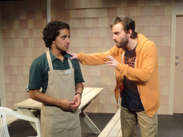 "Alan E. Garcia (left) and Cooper Harris-Turner in ReAct's ""The Aliens,"" Annie Baker's play about two shiftless 30-somethings who hang out behind a Vermont cafe and meet an impressionable teenager. (David Hsieh)"