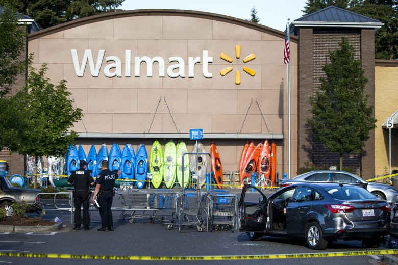 Police investigate the scene of a shooting at a Walmart in Tumwater, Washington Sunday June 17, 2018.  (Bettina Hansen / The Seattle Times)
