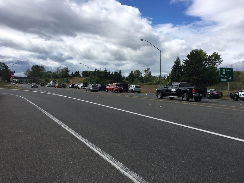 The State Patrol on Wednesday afternoon closed Highway 509 at South 160th Street near Sea-Tac International Airport after four vehicles were hit by gunfire.  (Washington State Patrol)
