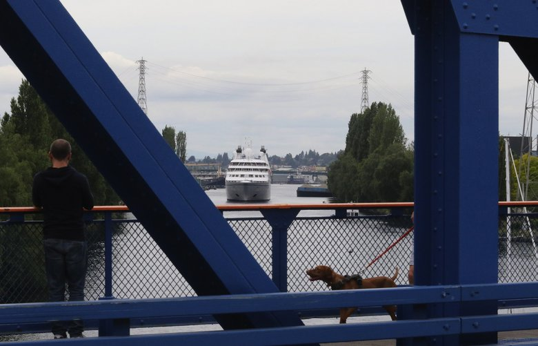 The Star Legend slowly powers its way towards the Fremont Bridge and a tour of Lake Union Wednesday. (Alan Berner / The Seattle Times)