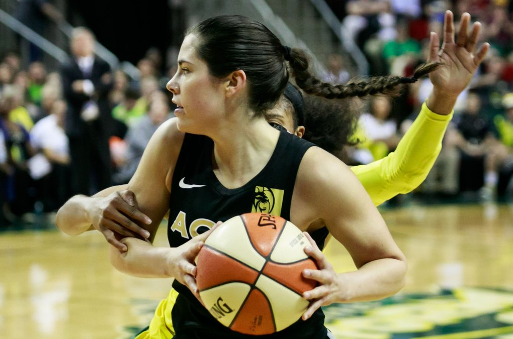 Seattle's Jordin Canada (21) guards Las Vegas' Kelsey Plum (10) during the second quarter of the Seattle Storm versus Las Vegas Aces game at KeyArena in Seattle Tuesday, June 19, 2018. (Erika Schultz / The Seattle Times)
