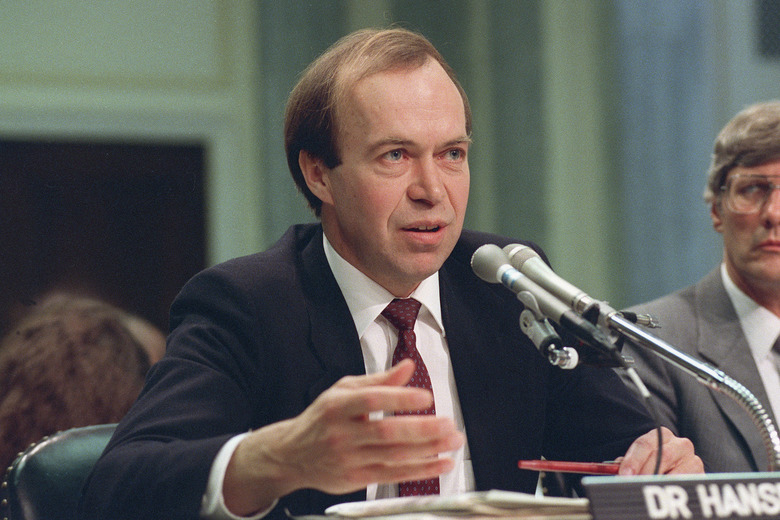 FILE – In this May 9, 1989 file photo, Dr. James Hansen, director of NASA's Goddard Institute for Space Studies in New York, testifies before a Senate Transportation subcommittee on Capitol Hill in Washington, D.C., a year after his history-making testimony telling the world that global warming was here and would get worse. (AP Photo/Dennis Cook, File)