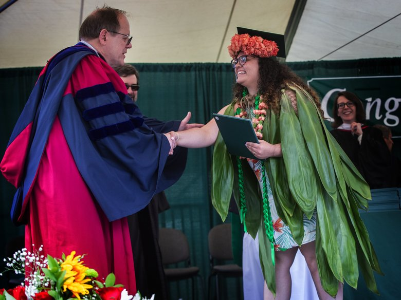 The Evergreen State College President George Bridges shakes hands with a graduate after she receives her diploma.  (Ellen M. Banner/The Seattle Times)