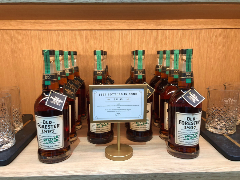 In this Thursday, June 7, 2018, photo, bottles of Kentucky straight bourbon whisky are displayed at Old Forester Distilling Co. in downtown Louisville, Ky. Old Forester, the bourbon that launched a family dynasty and a spirits company, has returned to its pre-Prohibition Kentucky home in a newly renovated building that symbolizes the brand's comeback. (AP Photo/Bruce Schreiner)