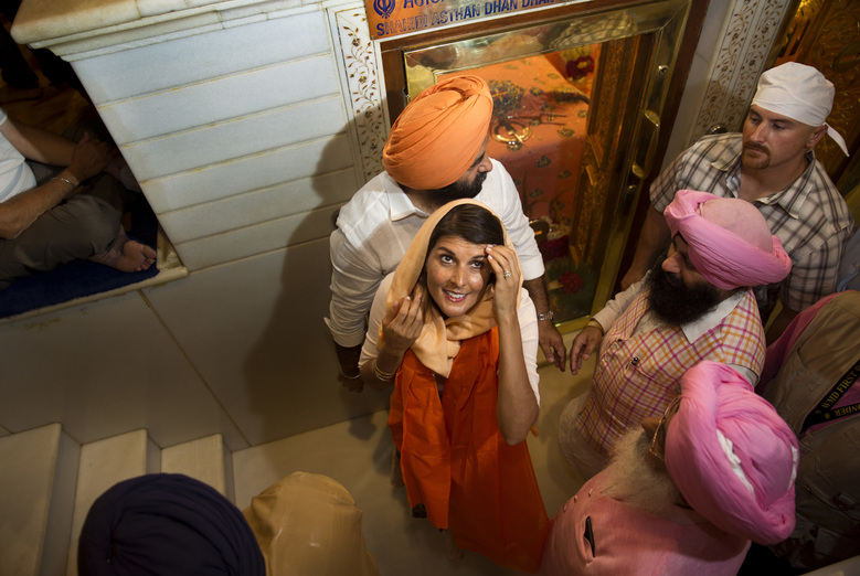 U.S. Ambassador to the United Nations Nikki Haley, center, leaves after praying at the Gurdwara Sis Ganj Sahib, a Sikh temple, in New Delhi, India, Thursday, June 28, 2018. Nikki Haley offered inter-faith prayers in New Delhi on Thursday, visiting a Sikh shrine, a Hindu temple, a Jain temple, a Church and a Muslim mosque in the old, walled area of the Indian capital. (AP Photo/Manish Swarup)