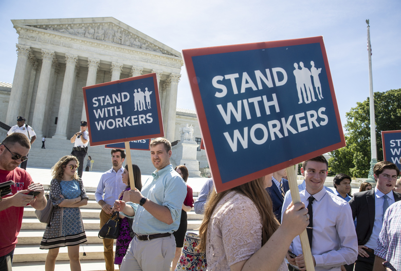 People gather at the Supreme Court before Wednesday's decision that government workers can't be forced to contribute to labor unions that represent them in collective bargaining, dealing a financial blow to organized labor. (AP Photo / J. Scott Applewhite)