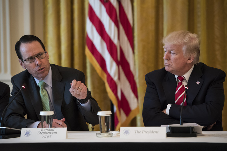 President Donald Trump listens to AT&T CEO Randall Stephenson during an event at the White House in Washington in 2017. Washington Post photo by Jabin Botsford