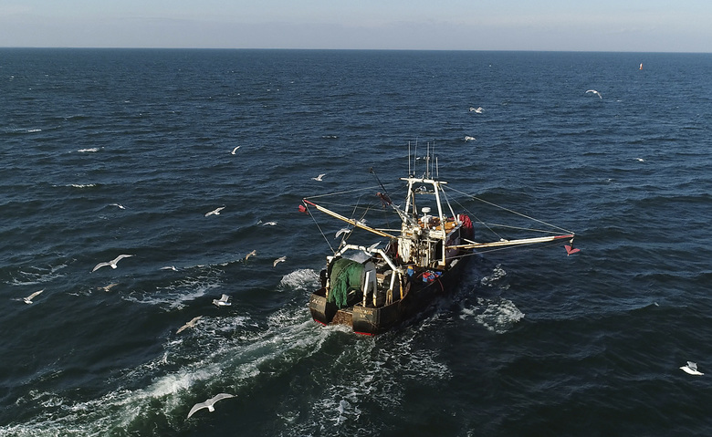A fishing trawler makes its way to open water from Montauk, N.Y. for a day trip to fish off the coast Long Island on Tuesday, Dec. 19, 2017. (AP Photo/Julie Jacobson)