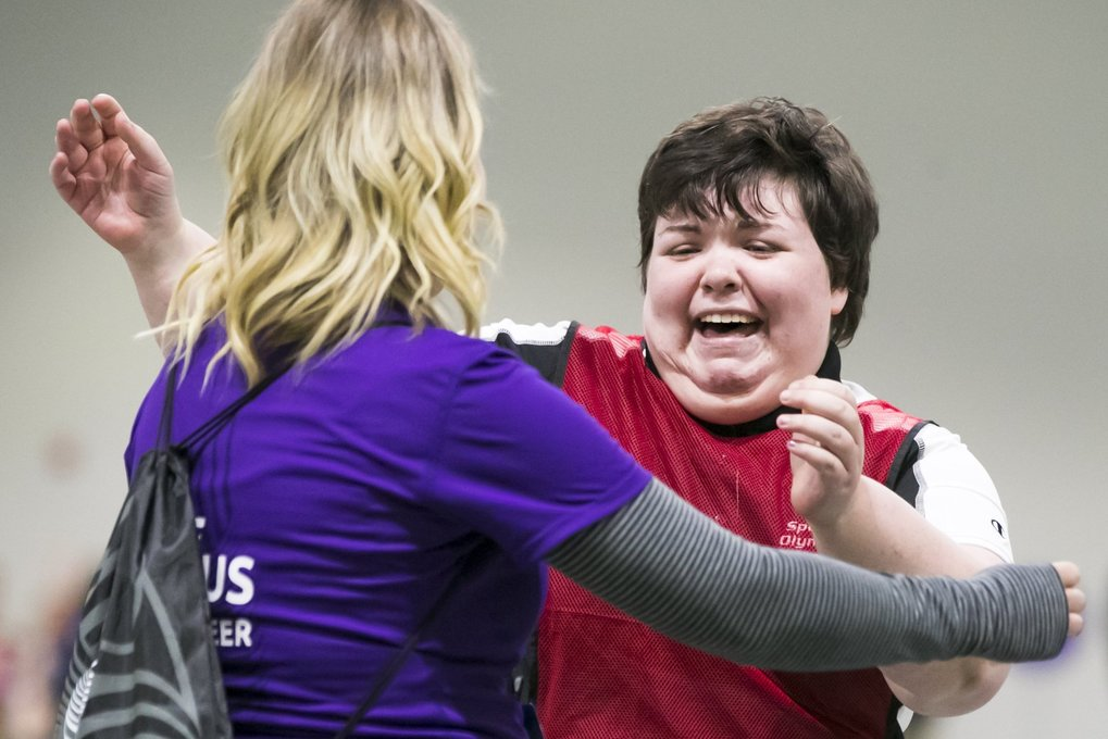 Moira Schwerdtfeger of Virginia lets out a yell of joy and hugs a volunteer after winning her singles Bocce match at the Special Olympics USA Games at the University of Washington's Dempsey Indoor Center Monday, July 2, 2018. (Bettina Hansen / The Seattle Times)