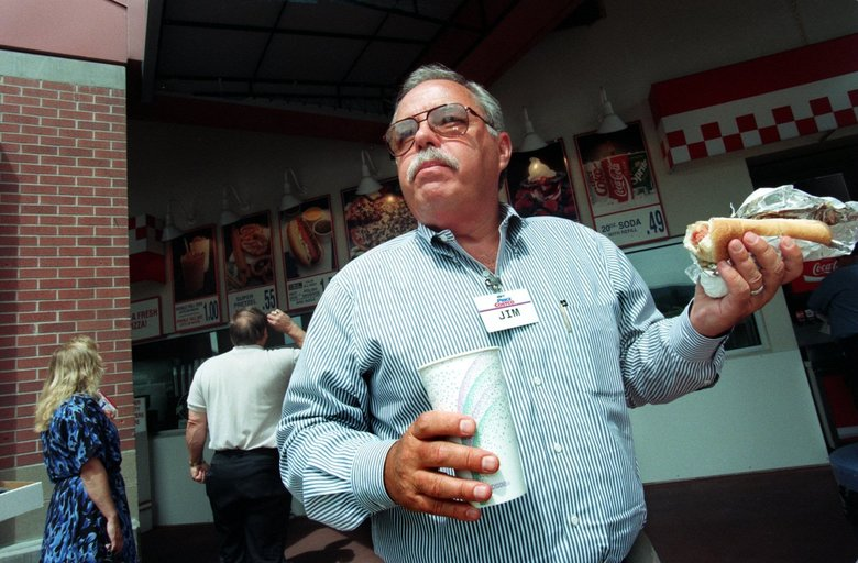 Jim Sinegal, co-founder and former CEO of Costco,  with one of the retail giant's signature deals, a hot dog and drink for $1.50. (Rod Mar / The Seattle Times, 1997)
