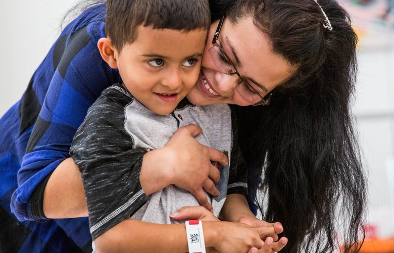 Asylum seeker Yolany Padilla is reunited with her son, Jeslin in the Seattle-Tacoma International Airport on July 14, 2018, after nearly two months of separation. Padilla was detained at the southern border on her way from Honduras, and Jeslin was sent to the Office of Refugee Resettlement in New York. 207021