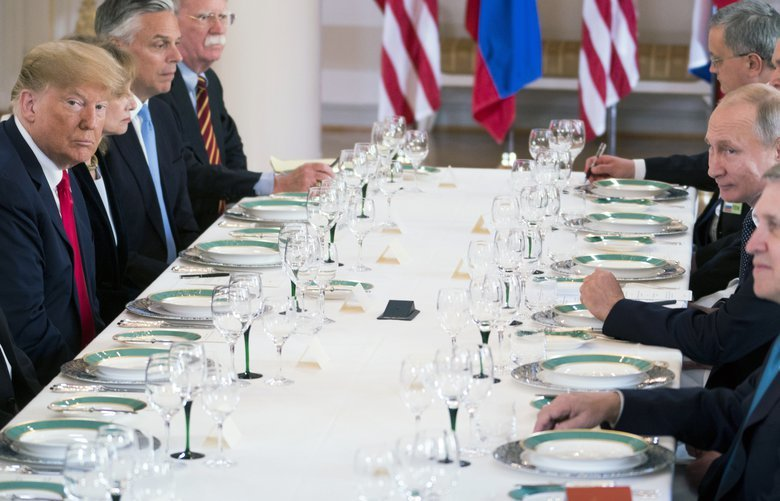 President Donald Trump, left, attends a working lunch with President Vladimir Putin of Russia, third from right, in Helsinki, Finland, on Monday, July 16, 2018. (Doug Mills/The New York Times)  XNYT22 XNYT22