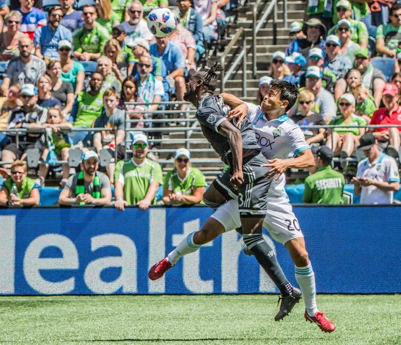Seattle Sounders Kim Kee-hee collides with the Vancouver Whitecaps Kei Kamara during the game at CenturyLink Field on Saturday. The Sounders beat the Whitecaps 2-0. (Rebekah Welch / The Seattle Times)