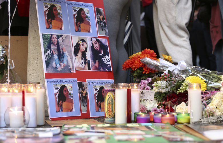 A memorial for 18-year-old Nia Wilson takes shape outside Bay Area Rapid Transit's MacArthur Station, Monday, July 23, 2018, a day after she was fatally stabbed on a platform at the station, in Oakland, Calif. (AP Photo/Lorin Eleni Gill) RPLG104 RPLG104