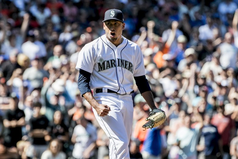 Mariners relief pitcher Edwin Diaz celebrates striking out the side to end the game with a 3-2 win as the Seattle Mariners take on the San Francisco Giants at Safeco Field in Seattle on Wednesday. (Bettina Hansen / The Seattle Times)