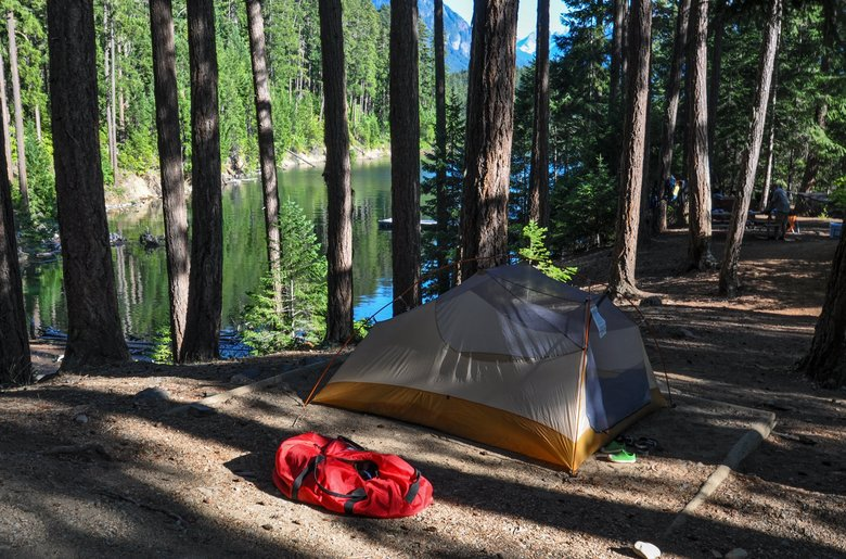 The author's campsite at Rainbow Point, one of only three sites at this campground, reserved 24 hours in advance. The spot features lake views in two directions and plenty of trees from which to hang a hammock. (Jeff Layton / Special to The Seattle Times)
