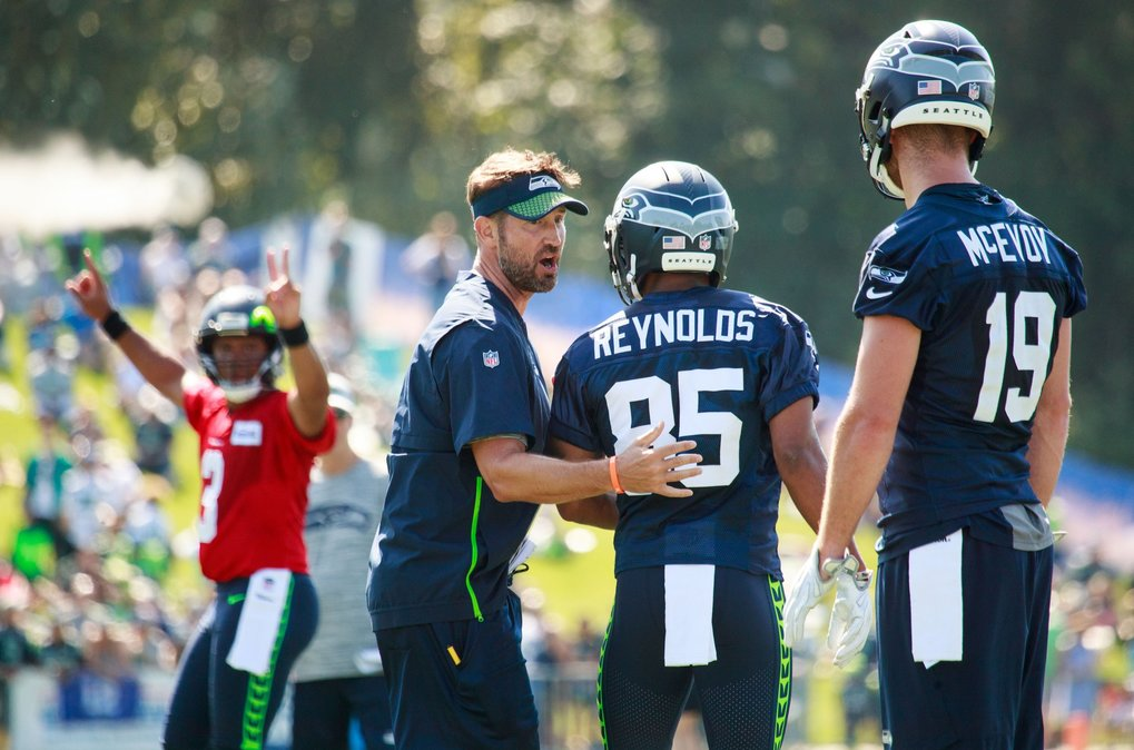 Offensive coordinator Brian Schottenheimer communicates during drills at the second day of Seahawks training camp. (Erika Schultz / The Seattle Times)