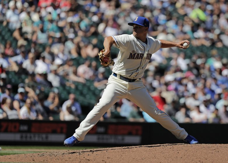 Mariners starter Marco Gonzales pitches against the Chicago White Sox during the fifth inning.  (Ted S. Warren / The Associated Press)
