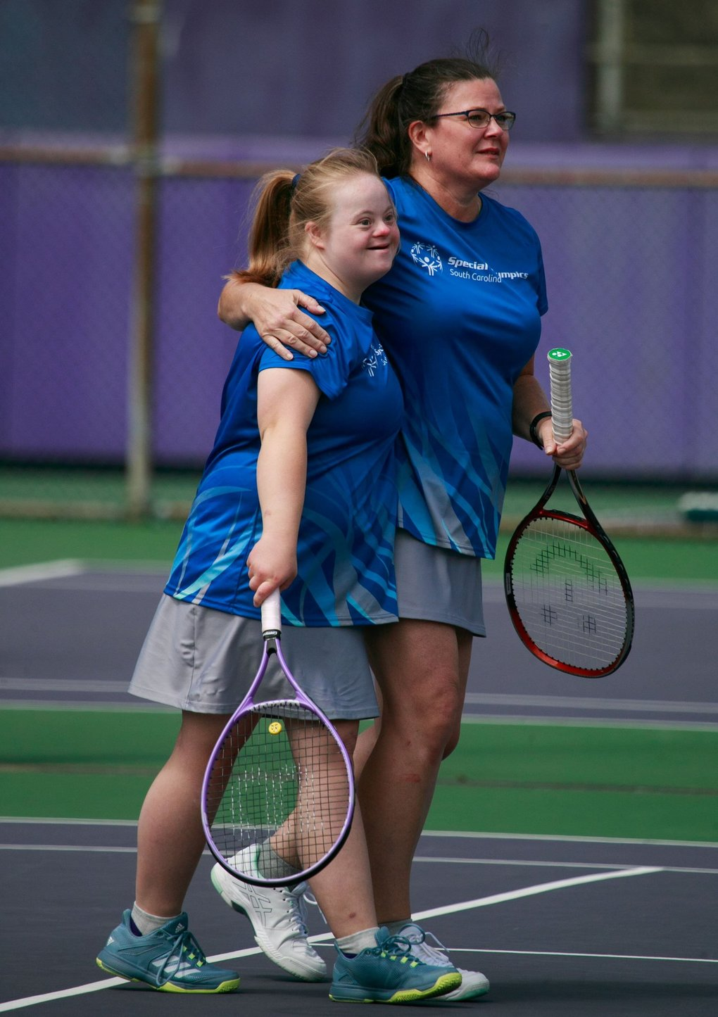 Erin Coats and her mother, Nadine Coats, of South Carolina, hug while competing in tennis during the Special Olympics USA Games at the University of Washington in Seattle on Wednesday. (Erika Schultz / The Seattle Times)
