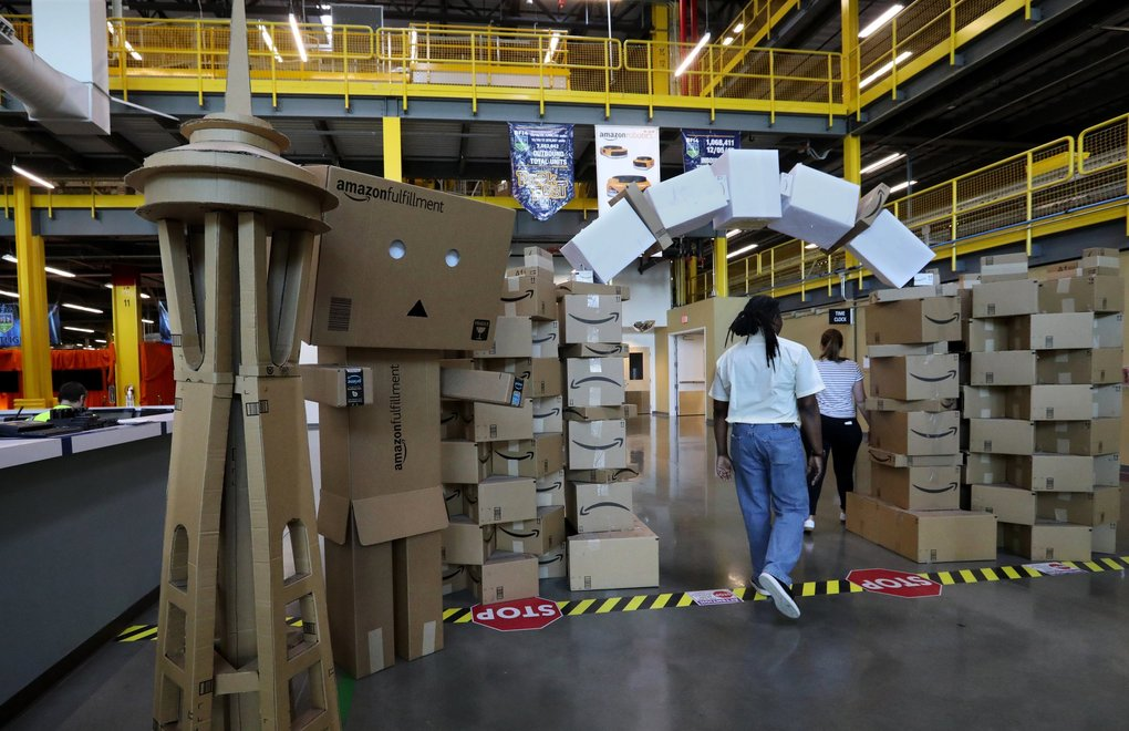 Workers at this Amazon fulfillment center in Kent built their own Space Needle, archway, and robot out of shipping containers.  (Alan Berner / The Seattle Times)