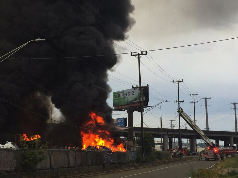 Fire spreads Wednesday night through a warehouse at 3651 E. Marginal Way South. (Sandi Doughton / The Seattle Times)