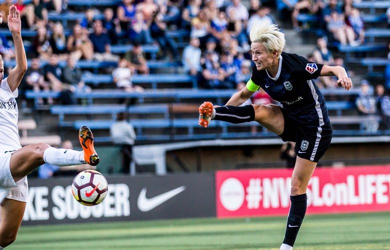Seattle Reign's Megan Rapinoe attempts a shot over  the Utah Royal's Katie Bowen during the game at Memorial Stadium on Wednesday, July 11, 2018. 206910
