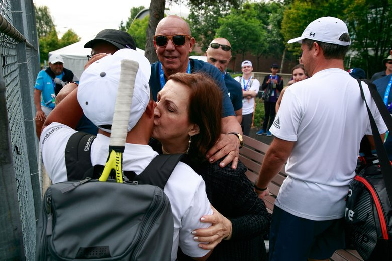 Grandmother Ana Celia Rivera kisses Santiago Castro, 22, after his tennis match. (Erika Schultz/The Seattle Times)