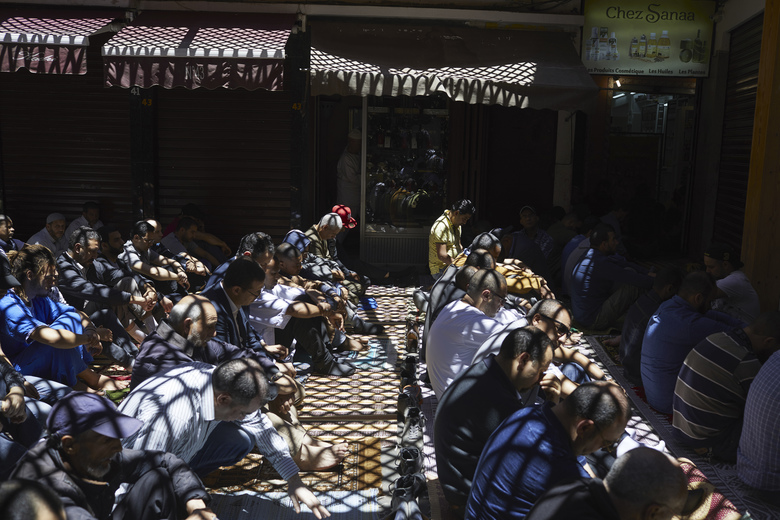 Local men pray in the Ancienne Medina, the old city of Casablanca, Morocco, not far from Rick's Cafs. (KSENIA KULESHOVA/NYT)