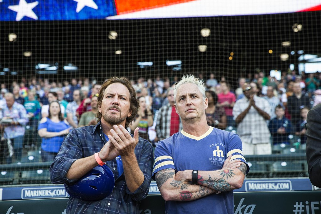 Pearl Jam's Eddie Vedder, left, and Mike McCready, attending a Mariners game last month, will return to Safeco Field for a pair of concerts Aug. 8 and 10 that will benefit organizations serving people experiencing homelessness (Dean Rutz / The Seattle Times)