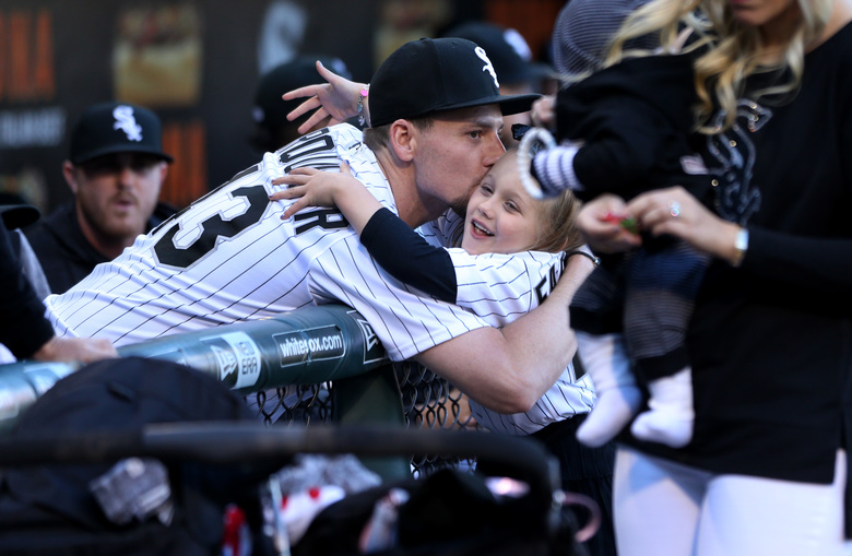 White Sox pitcher Danny Farquhar has some fun with family members before throwing out a ceremonial first pitch at a June 1 home game. (Chris Sweda/TNS)