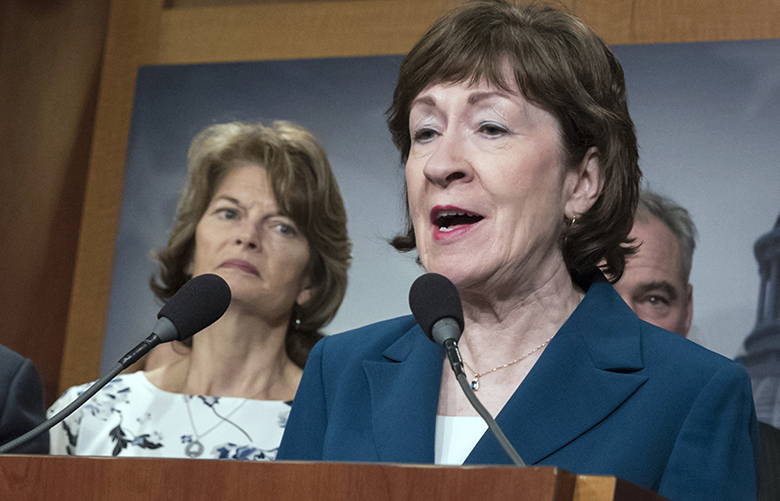 FILE – In this Feb. 15, 2018 file photo, Sen. Susan Collins, R-Maine and Sen. Lisa Murkowski, R-Alaska, left, are shown during a news conference at the Capitol in Washington.   The Senate battle over Donald Trump's new Supreme Court nominee is off to a fiery start _ even before the president makes his choice. Republican and Democratic leaders traded accusations and barbed comments Thursday on the new vacancy, abortion rights and the debate to come.  (AP Photo/J. Scott Applewhite)