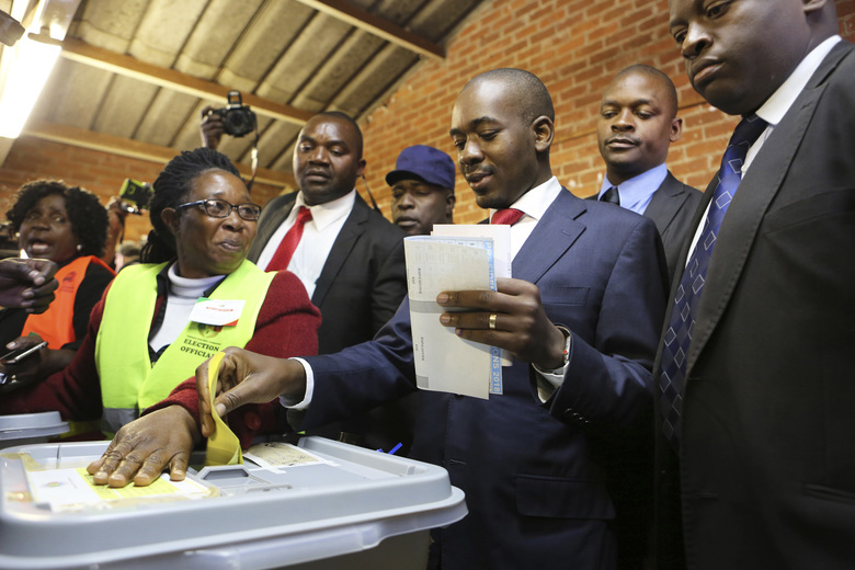 Zimbabwe's main opposition leader Nelson Chamisa casts his vote at a polling station in Harare, Zimbabwe, Monday, July 30, 2018. Zimbabwe votes in an election that could, if deemed credible, tilt the country toward recovery after years of economic collapse and repression under former leader Robert Mugabe. (AP Photo/Tsvangirayi Mukwazhi)