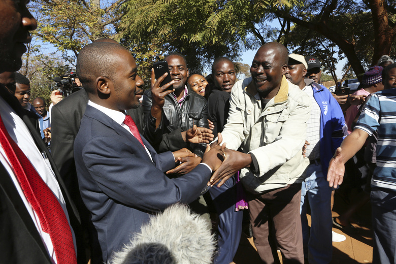 Zimbabwes main opposition leader Nelson Chamisa greets supporters after casting his vote at a polling station in Harare, Zimbabwe,Monday, July 30, 2018. About 5.5 million people are registered to vote in this southern African nation. (AP Photo/Tsvangirayi Mukwazhi)
