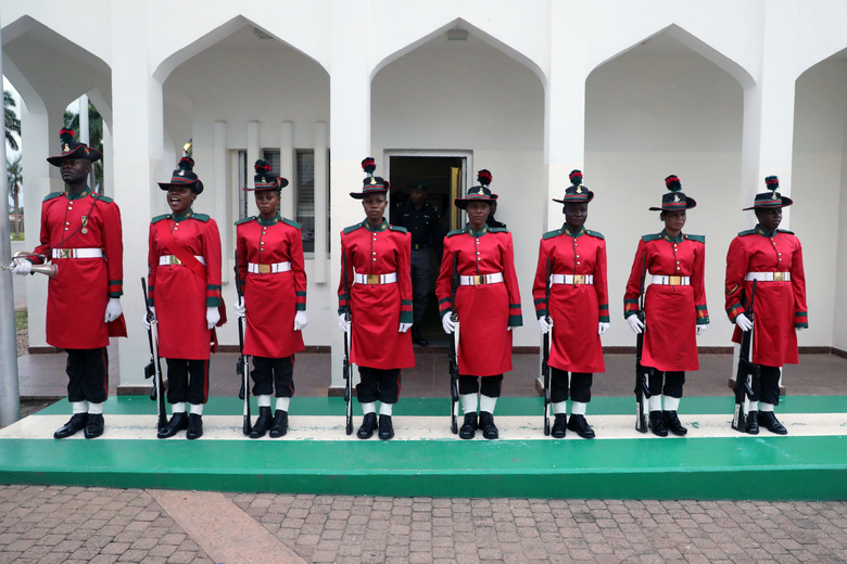 In this picture taken on Tuesday, July 3, 2018 Nigeria's guard of honor stand at attention before a meeting between Nigeria's President Muhammadu Buhari and his French counterpart Emmanuel Macron at the Presidential State House, in Abuja, Nigeria. Macron has arrived in Abuja for a meeting with his Nigerian counterpart Muhammadu Buhari, in his latest attempt to forge closer ties with English-speaking Africa. (Ludovic Marin/Pool Photo via AP)