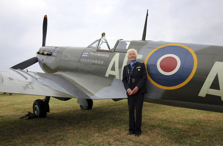 FILE – In this file photo dated Aug. 18, 2015, showing RAF Veteran World War II pilot Mary Ellis posing with a Spitfire at Biggin Hill Airfield, England. The Second World War pilot Ellis has died at the age of 101, is is announced Thursday July 26, 2018. Mary Ellis delivered spitfires and bombers to the front line during the war as a member of the Air Transport Auxiliary (ATA), flying over 1,000 planes during the conflict before moving to the Isle of Wight to manage Sandown airport from 1950 to 1970. (Gareth Fuller/PA via AP)