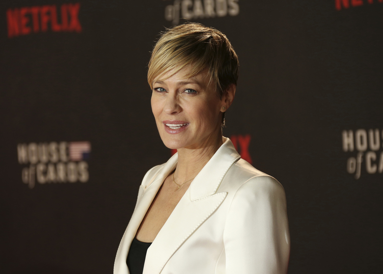 "FILE – In this Feb. 26, 2015, file photo, Actress Robin Wright poses for photographers upon arrival at the House Of Cards season 3 World Premiere at the Empire Cinema in central London. Wright said that the cast was surprised and saddened about the sexual misconduct allegations against former ""House of Cards"" co-star Kevin Spacey. Speaking in a taped interview Monday, July 9, 2018, on NBC's ""Today"" show, Wright says she really ""didn't know the man."" (Photo by Joel Ryan/Invision/AP, File)"