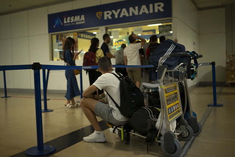 People queue at the Ryanair airline customer service desk during the first of two days cabin crew strike at Adolfo Suarez-Barajas international airport in Madrid, Wednesday, July 25, 2018. Budget airline Ryanair cabin crew are to stage a 48-hour strike July 25 and 26 in Spain, Portugal, Italy and Belgium. (AP Photo/Francisco Seco)