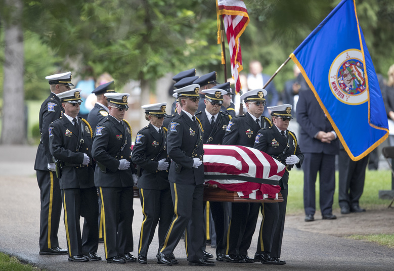 Pallbearers carried the body of correction officer Joseph Gomm to his gravesite at Roselawn Cemetery July 26, 2018 in Roseville, Minn. An inmate at Stillwater Correctional Facility killed Gomm in the line of duty. JERRY HOLT ' jerry.holt@startribune.com/Star Tribune via AP)