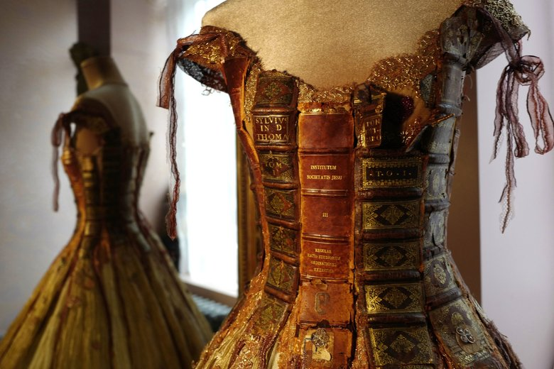 French designer Sylvie Facon used leather book spines to create the bodice for this fantastical gowns. (Michel Spingler / The Associated Press)
