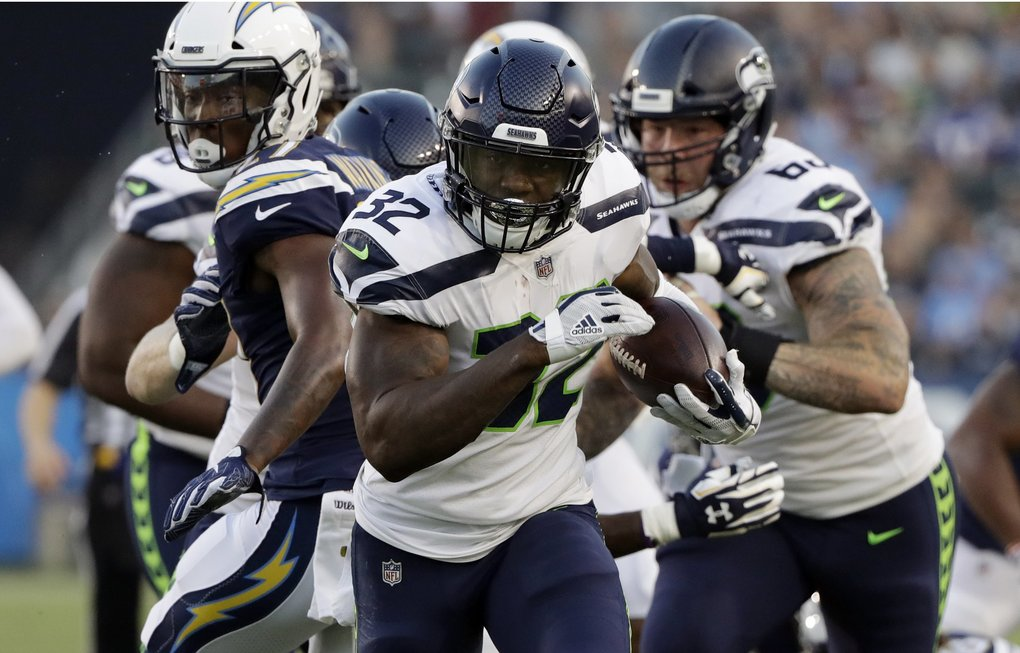 Seattle Seahawks running back Chris Carson (32) runs against the Los Angeles Chargers during the first half of an NFL preseason football game Saturday, Aug. 18, 2018, in Carson, Calif. (AP Photo/Gregory Bull)