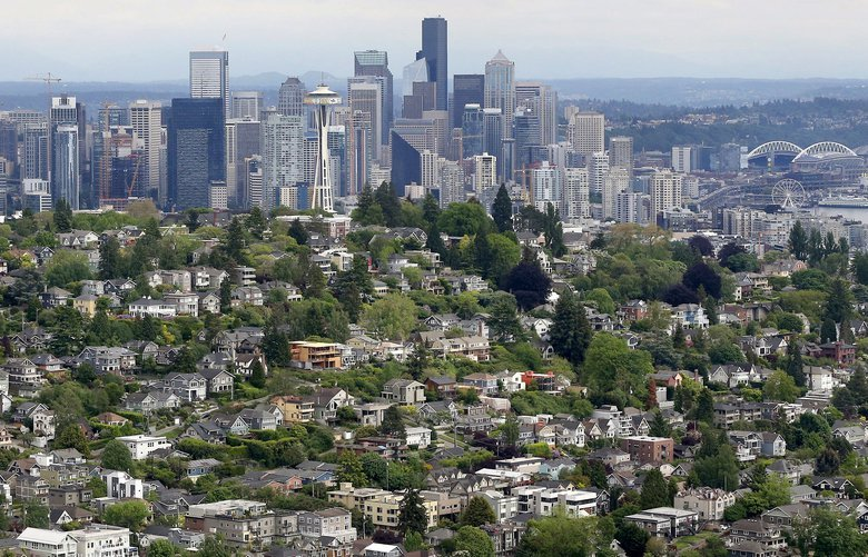 Traffic and Real Estate aerial The Seattle skyline, looking southeast, with Queen Anne Hill in the foreground, May 17, 2018.