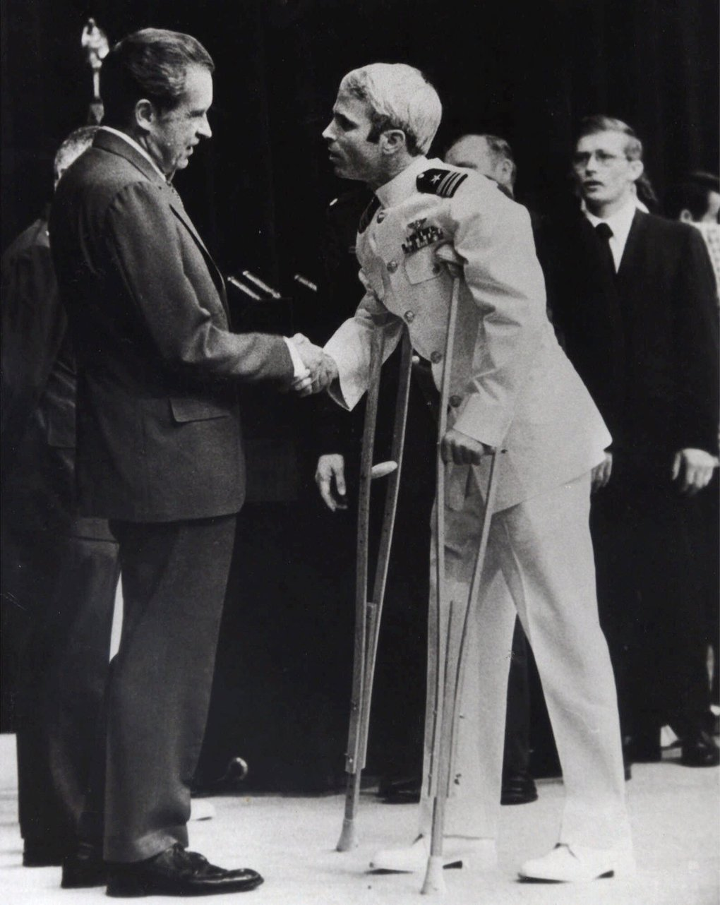 1973: U.S. Navy Lt. Cmdr. John McCain is greeted by President Richard Nixon, left, in Washington, after McCain's release from a prisoner of war camp in North Vietnam. (AP Photo/Harvey Georges, File)