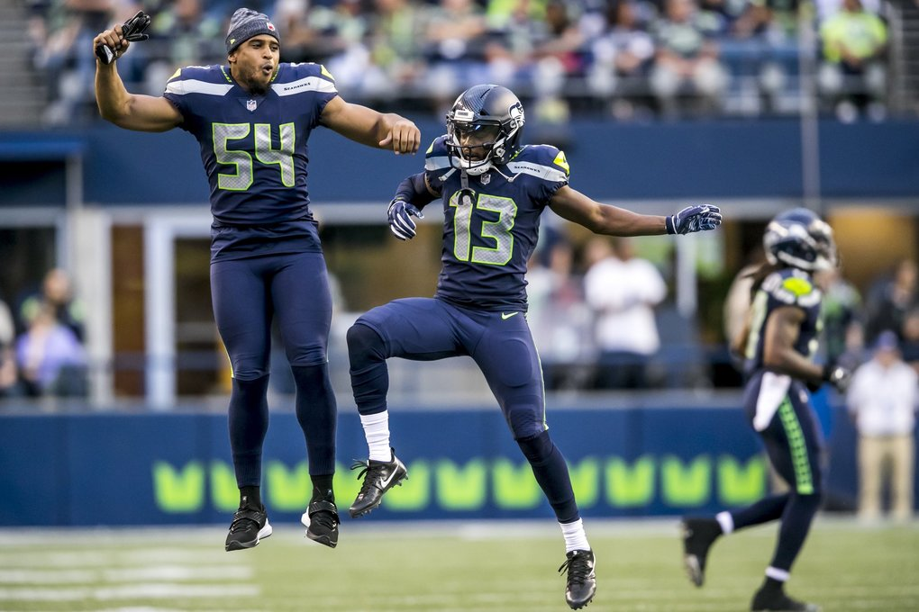 Seahawks linebacker Bobby Wagner celebrates with Seahawks wide receiver Cyril Grayson after his 35-yard kick return as the Seattle Seahawks take on the Oakland Raiders at CenturyLink Field in Seattle on Thursday for their final preseason game of 2018. (Bettina Hansen / The Seattle Times)